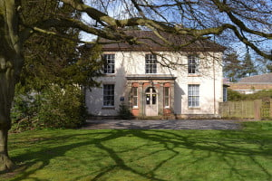 Hawthorn House is a locally listed building within the site which would be restored.