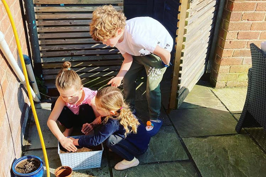 My children sowing wildflowers, excited to watch them germinate in the coming weeks and see them flower throughout the summer.